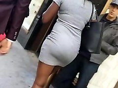 sexy tall dark skin ebony in tight grey dress.mp4