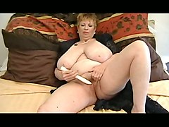 mature short haired ssbbw woman from russia masturbates on the bed