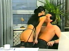 sexy and hot elegant brunette babe sucking cock in the office