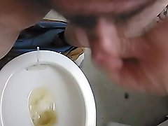 Pissing and stroking tiny cock