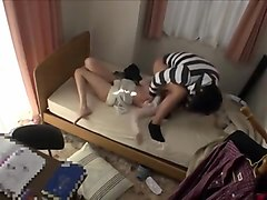 Pretty Japanese teen gets nailed by a horny guy on the bed