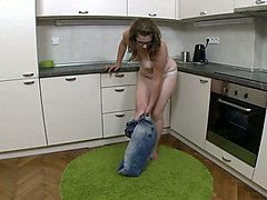 auburn haired nerdy girl with glasses undresses and masturbates with a corn toy