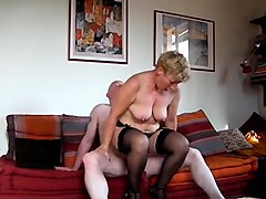 Mature blonde in stockings and high heels fucks a hard shaft