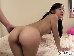 fine asian babe widens her pussy lips showing pink