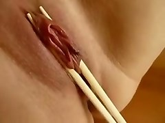 cute and sexy asian girl lets me squeeze her pussy lips wiht chopsticks