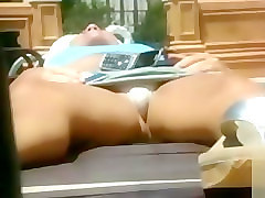 Tanning girl upskirt to see her tight panties