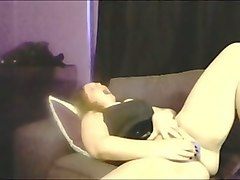 curly emotional redhead in black lingerie enjoys masturbating her wet cunt