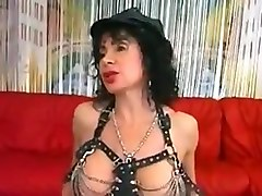 leather girl entertains two guys and a girl !