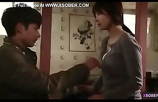 Booby Asian mom gives young guy his first touch