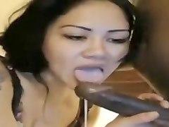 Oriental Slut Sucks On A Cam That Is Dark