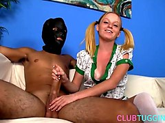 petite femdom tugging her masked subject