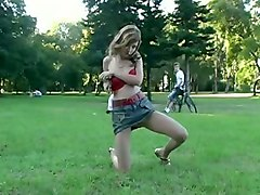 fabulous blonde sexy skinny girl in the park flashes her anus in doggy style position