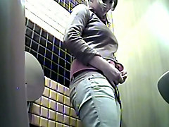 hidden cam in the ladies room catches young brunette