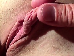 Manhandling and stretching her big clit labia hood pussy
