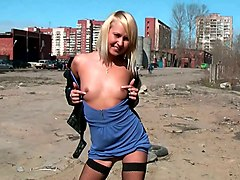 magnificent and lean russian blonde teen pulls down her dress