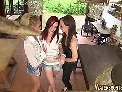 Lesbians piss outdoors