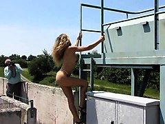 Slim blonde beauty displays the amazing contours of her body