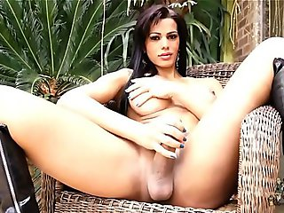 Nathany Gomes strokes her cock in a hammock