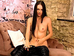 stunning brunette strips off leather catsuit fucks gold toy