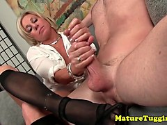 busty mature in stockings jerking on dick
