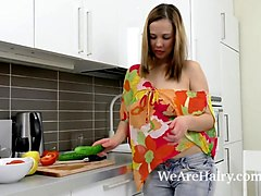 lina masturbates with a cucumber to orgasm