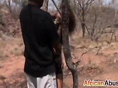 african chick blowing two stiff cocks outdoors