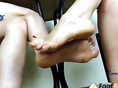 Barefoot girls playing footsies and having fun
