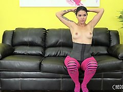 dana is feeling naughty in her stockings and corset as she