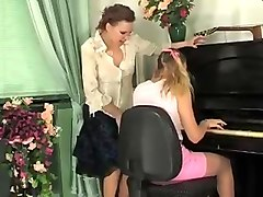 Lesbians plays in pantyhose and fucks with a strapon 2