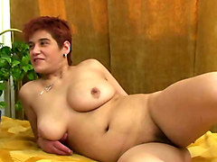 submissive and busty russian milf blows dick of a college guy on the bed