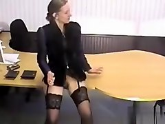 Kutasia is getting a pencil from the flasher that entered her office.