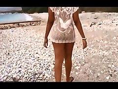 Twerking nude in public beach